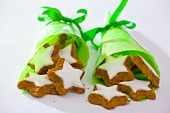 Star-shaped walnut biscuits in green paper cones
