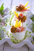 Boiled eggs stuffed with ham, mushrooms, peppers and cress