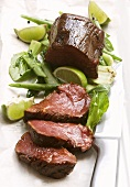 Beef fillet with pak choi and lime wedges