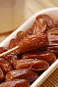 Dried dates with plastic fork (close-up)