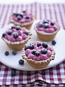 Four blueberry tarts