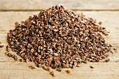 Cocoa nibs on wooden background