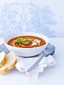 Tomato soup with pesto and crème fraîche