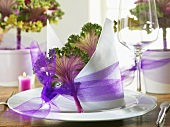 Napkin decoration with tulle ribbon & ornamental cabbage leaf