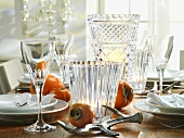Crystal glasses and sharon fruit on Christmas table