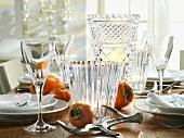 Crystal glasses and sharon fruit on Christmas table