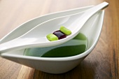Vegetable gnocchi with spring herb soup (molecular gastronomy)