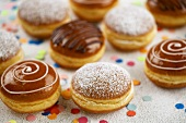 Assorted doughnuts with icing sugar & icing for Carnival