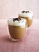 Baileys with milk foam and grated chocolate