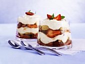 Layered strawberries and cream with amarettini
