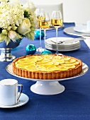 Orange and almond tart on festive table