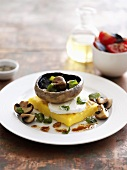 Portabella mushroom on a slice of polenta