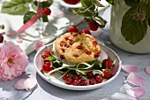 A raspberry and redcurrant muffin