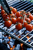 Cocktail tomatoes on a barbecue