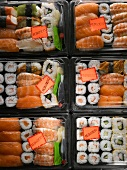 Sushi in plastic boxes with 'Reduced' labels