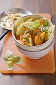Kohlrabi and carrots with pine nuts
