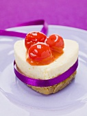 Heart-shaped quark cake with cocktail cherries