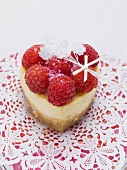 Heart-shaped quark cake with raspberries