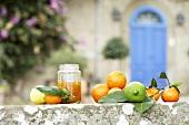 Oranges, lemons, mandarins and jar of orange marmalade