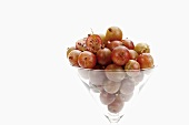 Fresh gooseberries in a glass