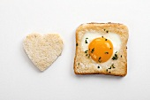 Egg in toast (or egg in the basket) with heart-shaped toast