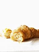 Croissant, broken, with butter