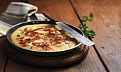 Apple and bacon pancake in a frying pan