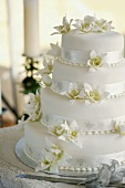 Four-tiered wedding cake with flowers