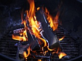 Burning charcoal on barbecue rack