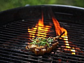 Lamb chop on a charcoal barbecue