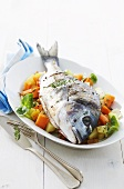 Roasted sea bream on a bed of vegetables
