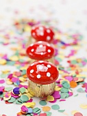Fly agaric chocolates on confetti