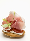 Prosciutto and rocket on cracker