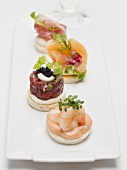 Assorted canapés with prawns, fish and prosciutto