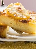 Pineapple upside-down cake, a piece cut