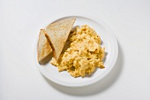 Scrambled egg with toast triangles