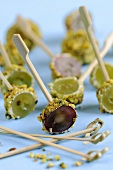 Grapes coated in goat's cheese & pistachios on cocktail sticks