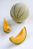 Whole cantaloupe melon and two slices