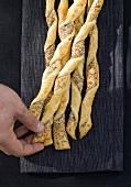 Hand holding savoury puff pastry straws