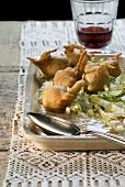 Sciatt (Cheese fritters in buckwheat batter on salad, Italy)