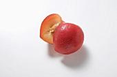 Halved red plum