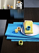 Table mats, napkin rings, napkins, sweets and espresso