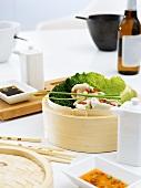 Wontons in bamboo steamer, garlic dip, chilli dip (Asia)