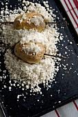 Potatoes baked in sea salt on baking tray