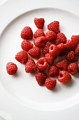 Fresh raspberries on plate (overhead view)