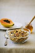 Fruit muesli with papaya and honey