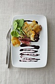 Beefsteak with potato crisps and spinach