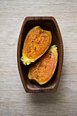 Prickly pear, halved, in wooden dish