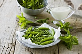 Fresh pea pods, mint and milk
