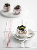 Yoghurt cream with blackberries in glass